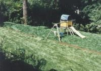 New sod lawn install in photo and  grading to remove slope backyard